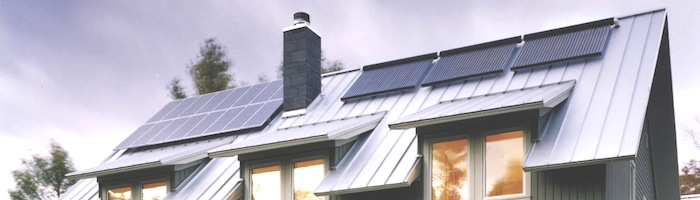 Apricus solar thermal collector and PV on house